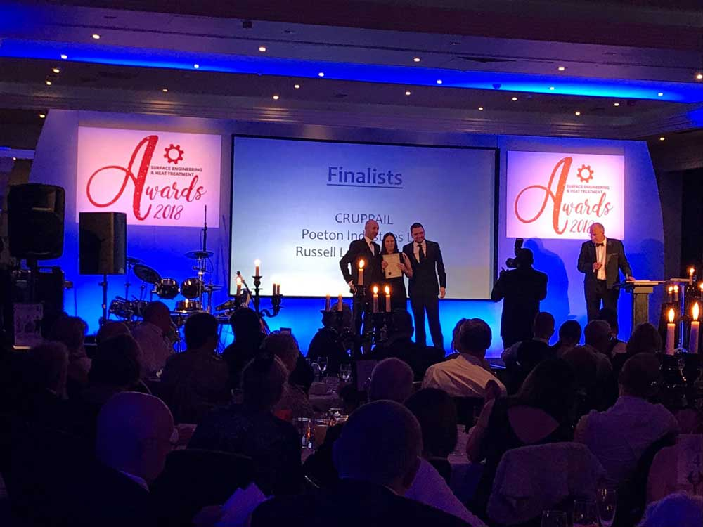 Poeton staff on stage at the SEA Awards