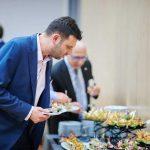 Guest choosing food at Poeton Polska launch event