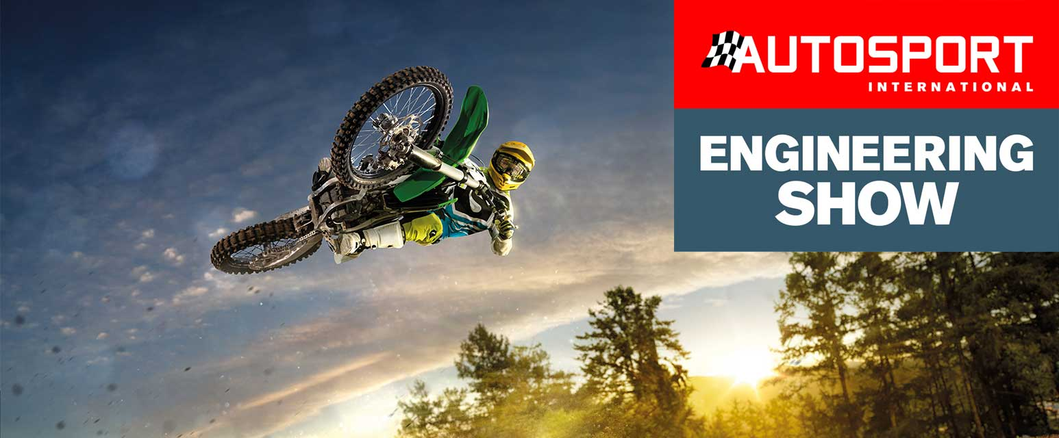 Motorbike jumping through air with Autosport engineering show logo