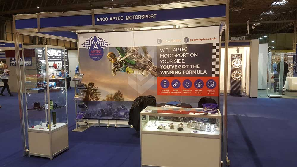 Aptec stand featured graphic banner with motorcycle at the Autosport show