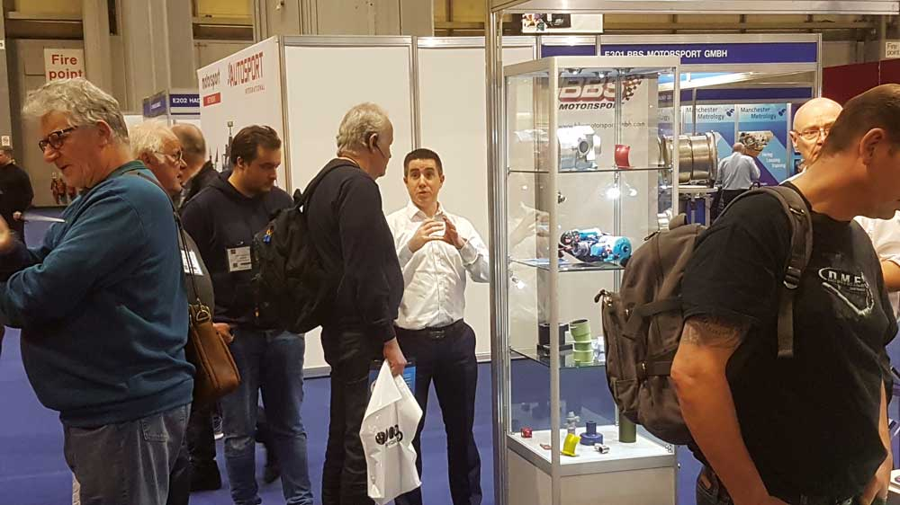 Poeton sales director discussing Aptec at the Autosport show