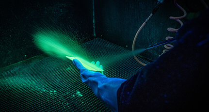 Fluorescent penetrant inspection being carried out