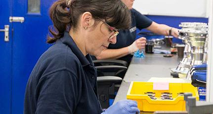Poeton masking staff preparing parts for precessing