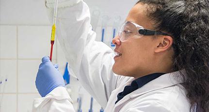 Poeton laboratory staff testing a lqiuid