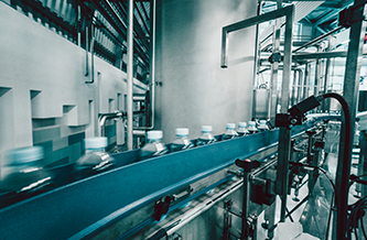 Drinks bottles moving along a factory processing line